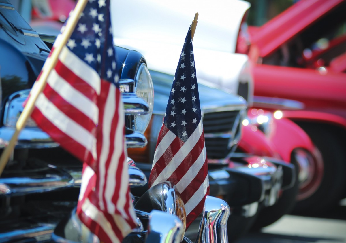 classic cars with flags on the front bumper